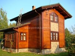 Комбинированная внешняя отделка брусового дома