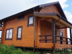 Внешняя отделка покраска дома из бруса