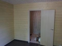 Реконструкция деревянного дома, отделка стен имитацией бруса